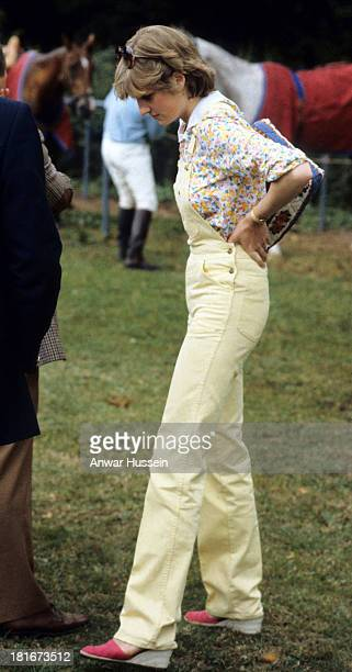 Lady Diana Spencer wearing dungarees attends a polo match at Windsor Great Park on July 12 1981 in Windsor England