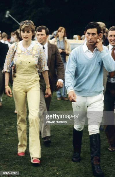 Lady Diana Spencer, wearing dungarees, attends a polo match with Prince Charles, Prince of Wales at Windsor Great Park on July 12, 1981 in Windsor,...