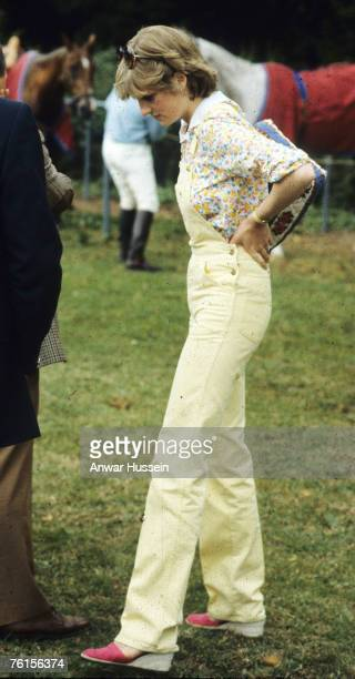 Diana Spencer later Princess of Wales dresses in casual dungarees while watching her future husband play polo in 1981