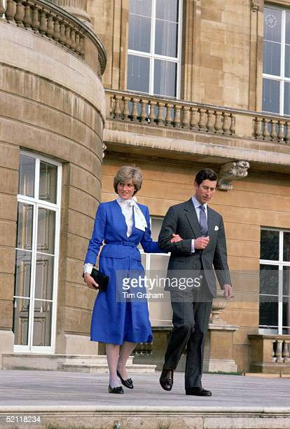 Lady Diana Spencer With Prince Charles Arm In Arm At Buckingham Palace On The Day Of The Announcement Of Their Engagement She Is Wearing A Royal Blue...