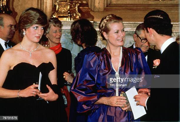 Lady Diana Spencer with Prince Charles, Prince of Wales and Princess Grace of Monaco at Goldsmiths Hall, London, attending a fund-raising concert and...