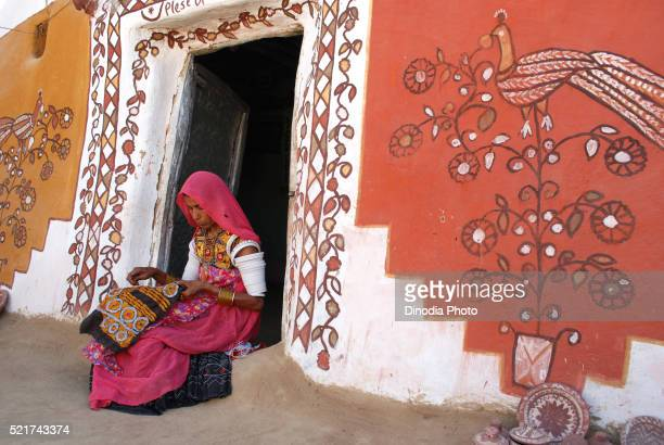 lady doing embroidery work on cloth, khuhri, jaisalmer, rajasthan, india - needlecraft stock pictures, royalty-free photos & images