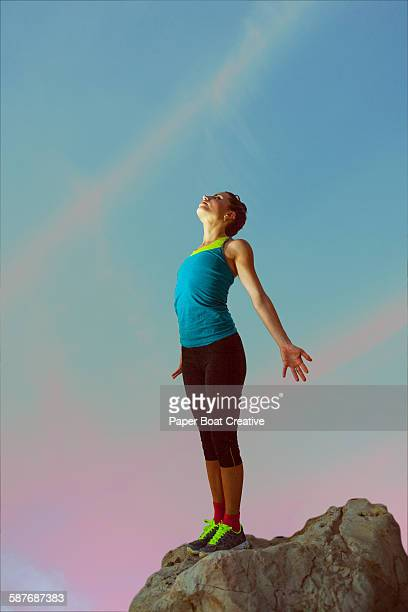 lady doing yoga and looking up at the sky - harriet stock photos and pictures
