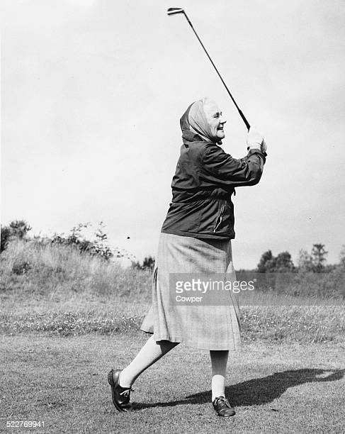 Lady Dorothy Macmillan wife of British Prime Minister Harold Macmillan swinging a golf club on the 18th hole during a visit to Gleneagles Scotland...