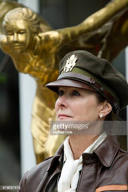 Lady dressed in military uniform and cap standing in front of large golden coloured Rolls Royce mascot at Goodwood on September 10 2016 in Chichester...