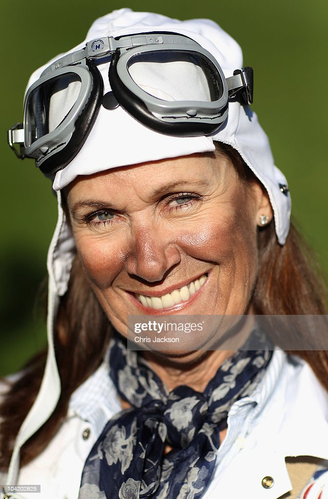 A lady dressed in vintage racing costume attends the Goodwood Revival 2010 at Goodwood on September 17, 2010 in Chichester, England.