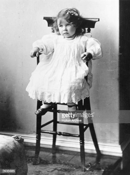 Lady Elizabeth Bowes-Lyon , future Queen Consort to King George VI sitting in a high chair on her second birthday.