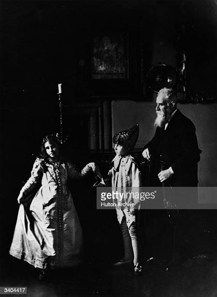 Lady Elizabeth BowesLyon future Queen Consort to King George VI with her brother David BowesLyon and their dance master in Glamis Castle her family...