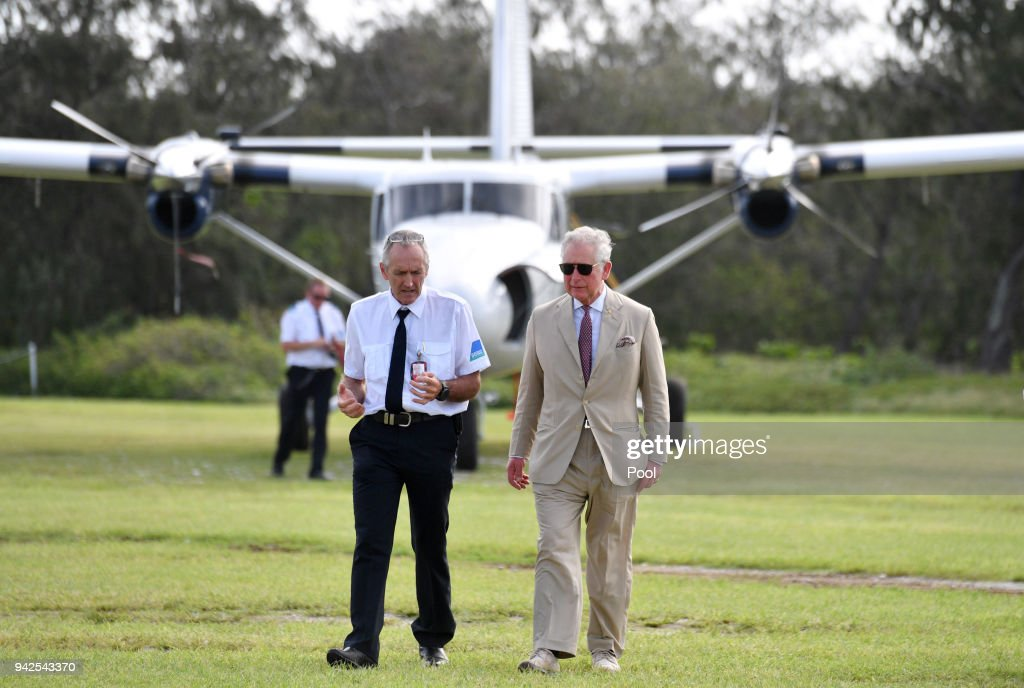 Lady Elliot Island head, Peter Gash and Prince Charles, Prince of Wales arrive for a roundtable meeting, discussing coral resilience on Lady Elliot Island on April 6, 2018 in Queensland, Australia. The Prince of Wales and Duchess of Cornwall are on a seven-day tour of Australia, visiting Queensland and the Northern Territory.