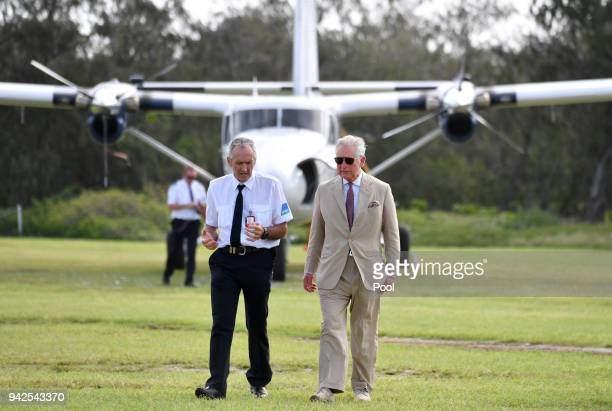 Lady Elliot Island head Peter Gash and Prince Charles Prince of Wales arrive for a roundtable meeting discussing coral resilience on Lady Elliot...