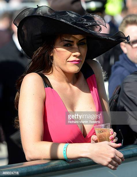 Lady enjoys a glass of champagne on Day 3 of the Aintree races at Aintree Racecourse on April 11 2015 in Liverpool England