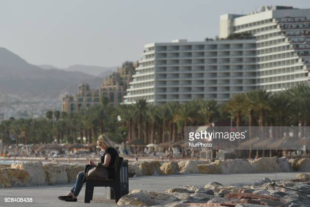 Lady enjoys reading a book near Hananya Beach in Eilat. On Tuesday, March 6 in Eilat, Israel.
