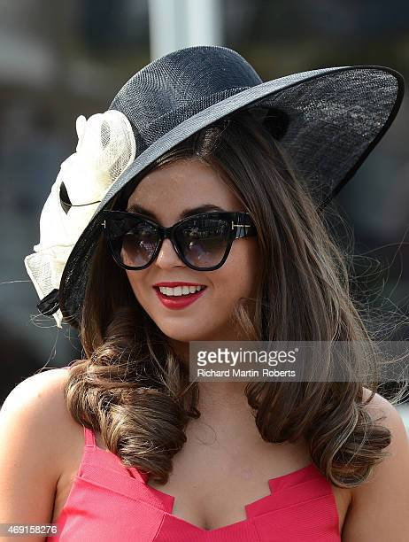 Lady enjoys the atmosphere on Day 2 of the Aintree races at Aintree Racecourse on April 10 2015 in Liverpool England