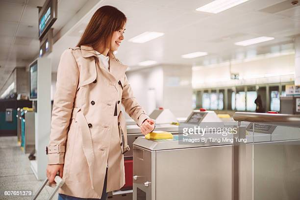 lady entering train platform with smartwatch - nfc stock pictures, royalty-free photos & images