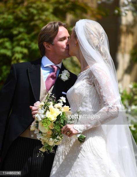 Lady Gabriella Windsor and Thomas Kingston share a kiss after marrying in St George's Chapel on May 18 2019 in Windsor England Photo by Victoria...
