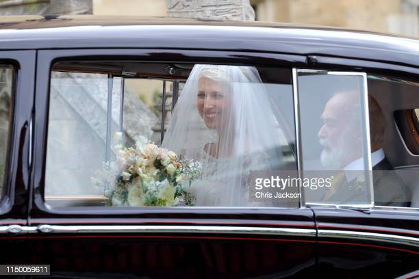 Lady Gabriella Windsor arrives in her car with her father Prince Michael of Kent for her wedding to Mr Thomas Kingston at St George's Chapel on May...