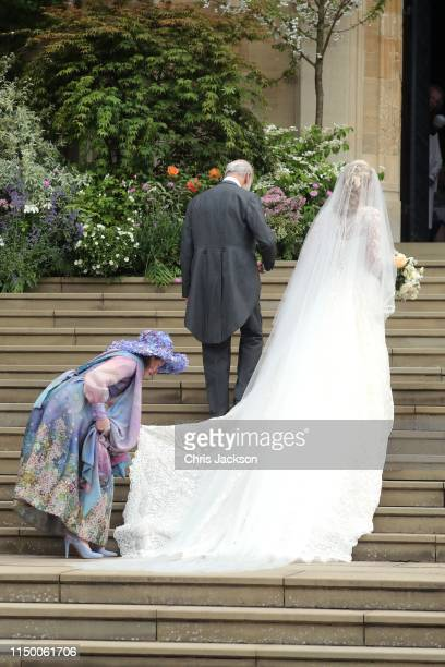 Lady Gabriella Windsor walks into the chapel with her father Prince Michael of Kent for her wedding to Mr Thomas Kingston at St George's Chapel on...