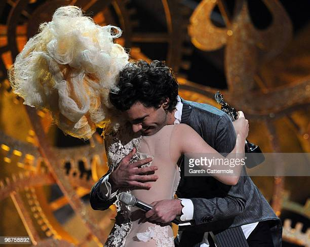 Lady Gaga accepts her award for 'Best International Album' from Mika on stage at The Brit Awards 2010 at Earls Court on February 16 2010 in London...