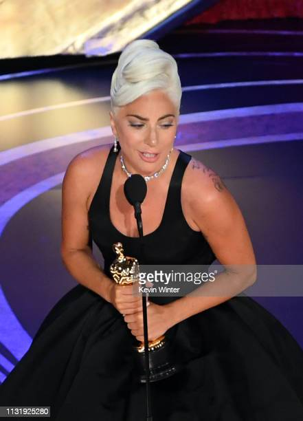 Lady Gaga accepts the Music award for 'Shallow' from 'A Star Is Born' onstage during the 91st Annual Academy Awards at Dolby Theatre on February 24...