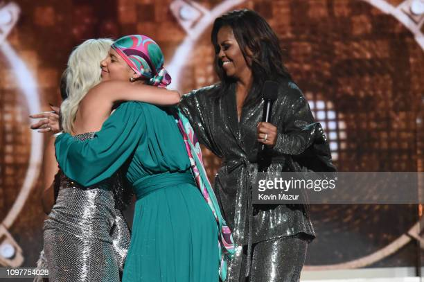 Lady Gaga Alicia Keys and Michelle Obama speak onstage during the 61st Annual GRAMMY Awards at Staples Center on February 10 2019 in Los Angeles...