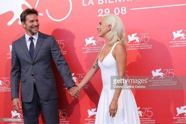 Lady Gaga and Bradley Cooper attend 'A Star Is Born' photocall during the 75th Venice Film Festival at Sala Casino on August 31 2018 in Venice Italy