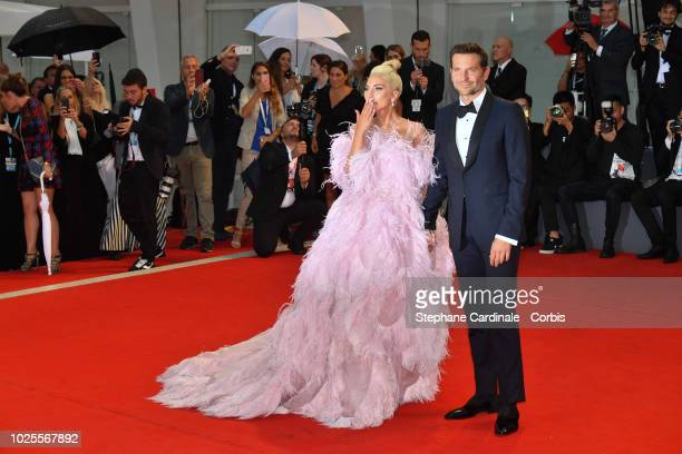 Lady Gaga and Bradley Cooper walk the red carpet ahead of the 'A Star Is Born' screening during the 75th Venice Film Festival at Sala Grande on...