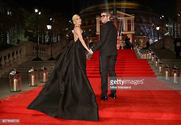 Lady Gaga and Brandon Maxwell attend The Fashion Awards 2016 on December 5 2016 in London United Kingdom