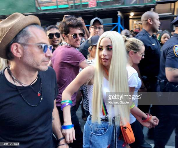 Lady Gaga and Christian Carino are seen at the 2018 New York City Pride March on June 24 2018 in New York City
