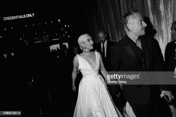 Lady Gaga and Christian Carino attend the 25th Annual Screen Actors Guild Awards at The Shrine Auditorium on January 27 2019 in Los Angeles...