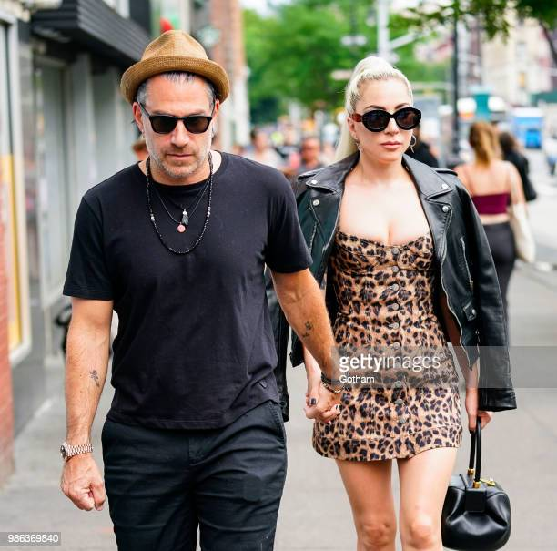 Lady Gaga and Christian Carino walk to her studio on June 28 2018 in New York City