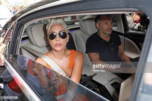Lady Gaga and her boyfriend Christian Carino leave her hotel on August 30 2018 in Paris France