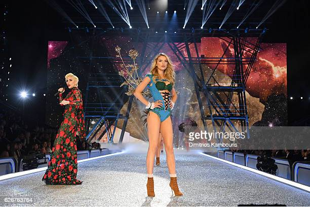 Lady Gaga and Lily Donaldson walk the runway during the 2016 Victoria's Secret Fashion Show on November 30 2016 in Paris France