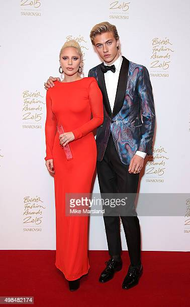 Lady Gaga and Lucky Blue Smith pose in the Winners Room at the British Fashion Awards 2015 at London Coliseum on November 23 2015 in London England