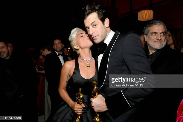 Lady Gaga and Mark Ronson pose with the Academy Award for Best Original Song during the 2019 Vanity Fair Oscar Party hosted by Radhika Jones at...