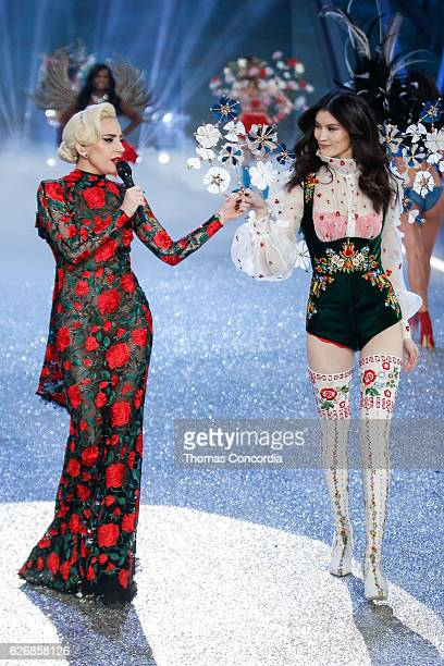 Lady Gaga and Sui He walk the runway during the 2016 Victoria's Secret Fashion Show at the Grand Palais in Paris on November 30 2016 in Paris France