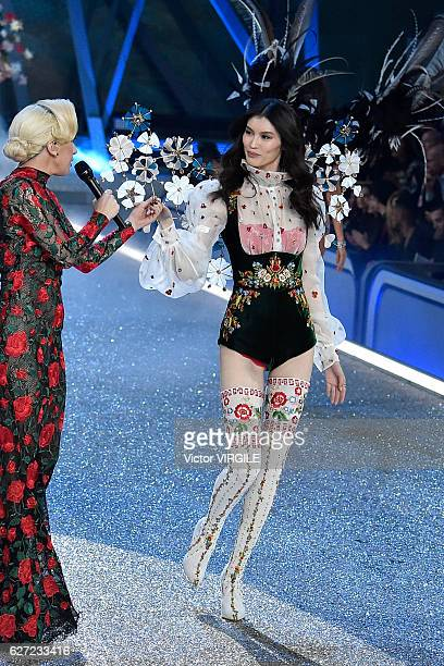 Lady Gaga and Sui He walks the runway during the 2016 Victoria's Secret Fashion Show on November 30 2016 in Paris France