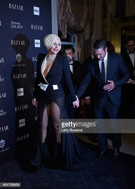 Lady Gaga and Taylor Kinney attend Moet Chandon and Belvedere Vodka Toast to Harper's Bazaar Icons at The Plaza Hotel on September 5 2014 in New York...