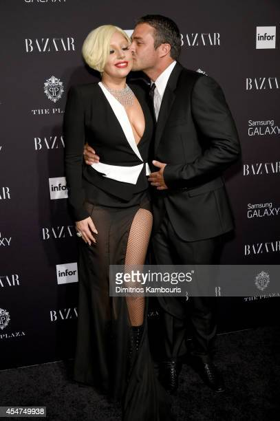 Lady Gaga and Taylor Kinney attend Samsung GALAXY At Harper's BAZAAR Celebrates Icons By Carine Roitfeld at The Plaza Hotel on September 5 2014 in...