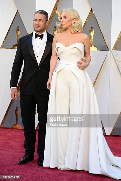 Lady Gaga and Taylor Kinney attend the 88th Annual Academy Awards at Hollywood Highland Center on February 28 2016 in Hollywood California