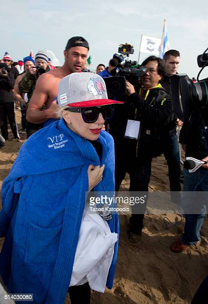 Lady Gaga and Taylor Kinney take part in the 16th Annual Polar Plunge at North Avenue Beach on March 6 2016 in Chicago Illinois