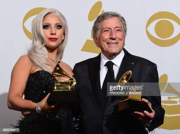 Lady Gaga and Tony Bennett hold their Grammys for Best Traditional Pop Vocals for their album Cheek to Cheek in the press room during the 57th annual...