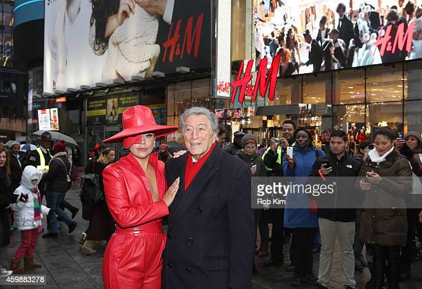 Lady Gaga and Tony Bennett view the HM Holiday Campaign at HM Flagship Store in Times Square on December 3 2014 in New York City