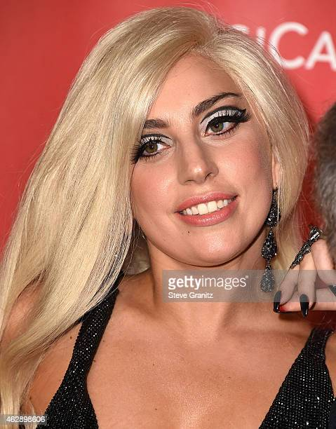 Lady Gaga arrives at the MusiCares Person Of The Year Tribute To Bob Dylan on February 6 2015 in Los Angeles California