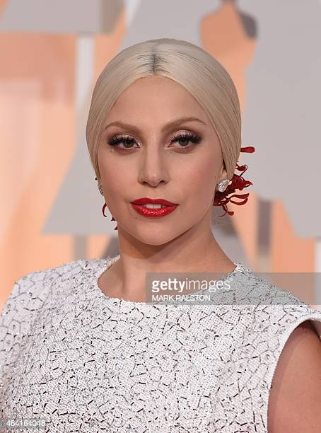 Lady Gaga arrives on the red carpet for the 87th Oscars February 22, 2015 in Hollywood, California. AFP PHOTO / MARK RALSTON