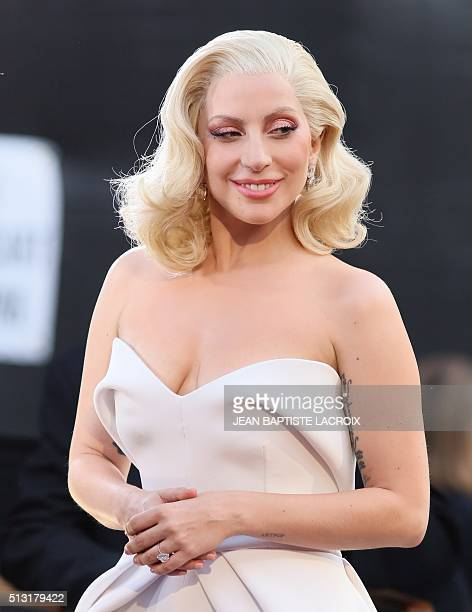 Lady Gaga arrives on the red carpet for the 88th Oscars on February 28 2016 in Hollywood California LACROIX