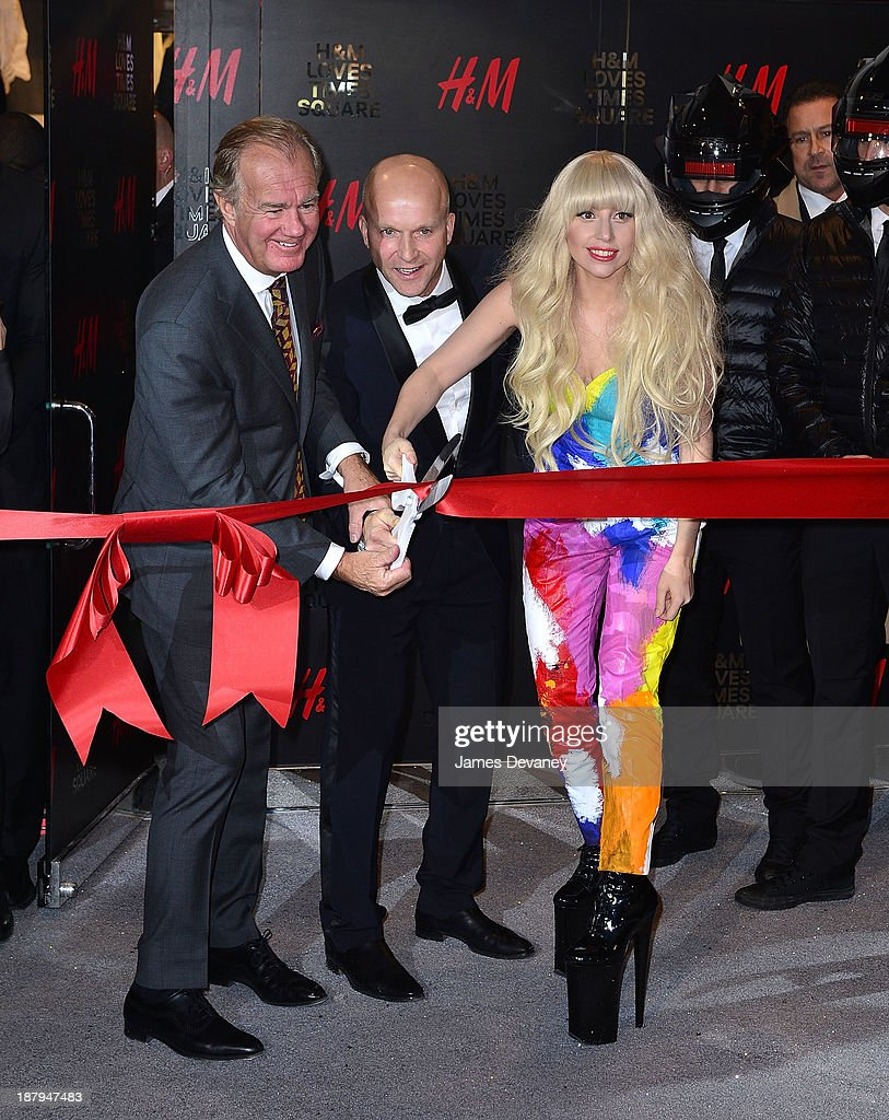 Lady Gaga (R) attends the H&M Times Square grand opening on November 13, 2013 in New York City.