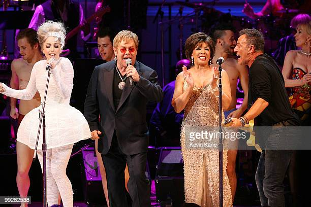Lady Gaga Elton John Dame Shirley Bassey and Bruce Springsteen perform on stage during the Almay concert to celebrate the Rainforest Fund's 21st...
