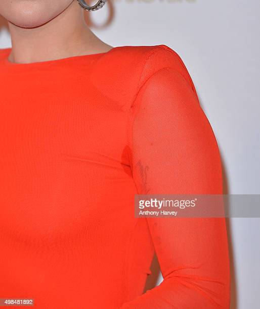 Lady Gaga fashion detail poses in the Winners Room at the British Fashion Awards 2015 at London Coliseum on November 23 2015 in London England