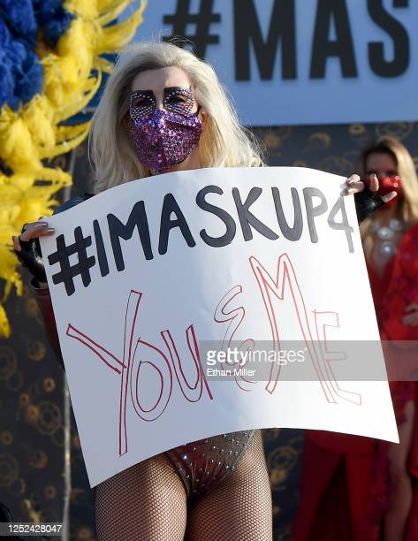 Lady Gaga impersonator Coty Alexander participates in a fashion show in front of the Welcome to Fabulous Las Vegas sign on the Las Vegas Strip to...