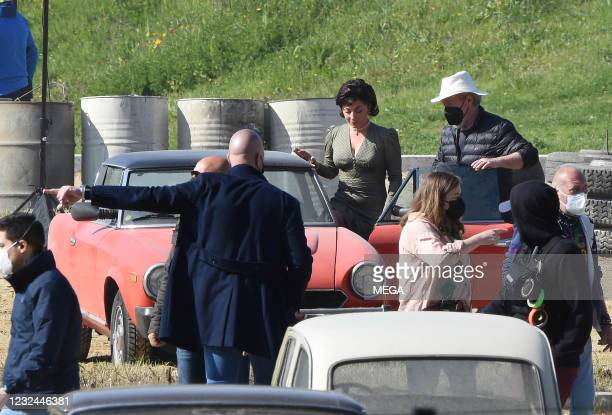 """Lady Gaga is seen filming """"House of Gucci"""" in a red Fiat Spide on April 21, 2021 in Rome, Italy."""